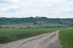 The dirt road leads to the old castle Stock Photography