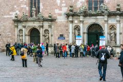 Near the Cathedral of St. Peter. Riga, Latvia, May 02: Tourists stroll through the square and get acquainted with the sights at the Cathedral of St. Peter in the royalty free stock photography