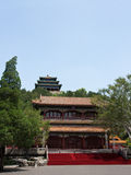 Near the Entrance to Jingshan Park, Beijing. Background, the first of three pagodas on Prospect Hill Royalty Free Stock Photos