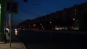 Night view of the entrance of the metro station Ramenki and traffic on Michurinsky Avenue, Moscow. Near the entrance into the underground station Ramenki it`s stock video