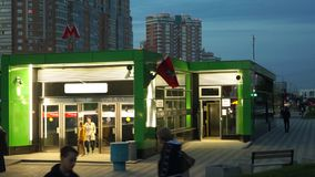 Night view of the entrance of the metro station Ramenki and traffic on Michurinsky Avenue, Moscow. Near the entrance into the underground station Ramenki it`s stock video footage