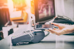 Near field communication NFC mobile phone payment. Royalty Free Stock Image