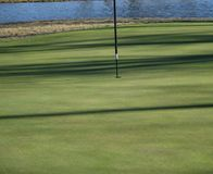 Putting green shown up close stock photo