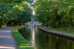 Canal near Pontcysyllte Aqueduct, Wrexham, Wales, UK. Near Froncysyllte, Wrexham, Wales, UK - August 30, 2016: A Narrowboat on the shore of the Llangollen Canal stock photos