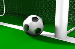 Near Goal. A 3D soccer ball standing on the goal line Stock Photography