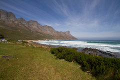 Near Gordons Bay, South Africa. Stunning mountain back drop to this scene Royalty Free Stock Photo