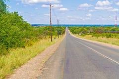 Near gräns för väg mellan Zambia och Zimbabwe Fotografering för Bildbyråer