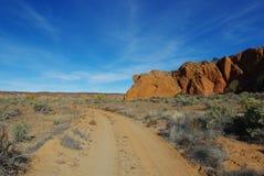 Near Harris Wash, Utah. Rocks and sandy road near Harris Wash, Utah Stock Images