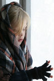 Near the icy window. A girl standing the icy window Stock Photography