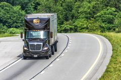 UPS Dual Trailer Rig Travels Interstate With Copy Space Stock Images