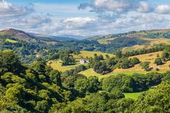 Near Llangollen, Denbighshire, Wales, UK. August 31, 2016: View from the Panorama Walk over the Denbighshire landscape with a single house in the centre royalty free stock photo