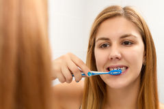 Near mirror and brushing teeth Royalty Free Stock Photo