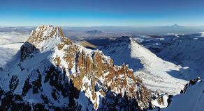 Near Mountain Aragats Armenia.The highest armenian`s peak. Autumn in Armenia. Mountain sky peaks snow sun blue snow Armenia Caucasus sky Sun Royalty Free Stock Image