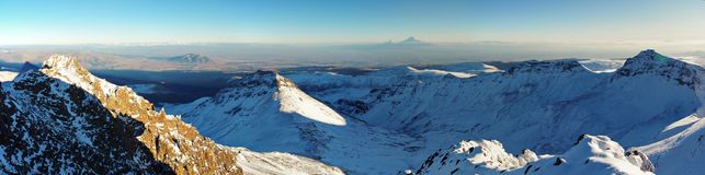 Near Mountain Aragats Armenia. the highest armenian`s peak. Autumn in Armenia. Mountain sky peaks snow sun blue snow Armenia Caucasus sky Sun Stock Images
