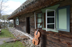 Near the old house musical instrument. Rumsiskes ethnographic museum in Lithuania Stock Images