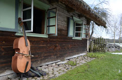 Near the old house musical instrument. Rumsiskes ethnographic museum in Lithuania Royalty Free Stock Photography