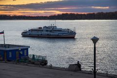 The trip motor ship on the Volga river in autumn evening. Samara city, Russia. Near old Volga river station stock photography