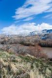 Near Palisade. The Grand Mesa rises behind the Colorado River as it passes near Palisade, Colorado Stock Photo