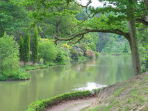 Near Peaceful Water. A moat near a country house on a hot summer's day royalty free stock photos