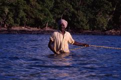 Near Port Blair, Andaman Islands, India, circa October 2002: Fisherman pulling the fishnet from the ocean. Andaman Islands, India, circa October 2002: Fisherman stock images