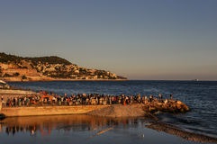 Near promenade des Anglais in Nice, France. People gathering for celebration near promenade des Anglais at sunset. Shot in Nice, France. Popular place in French Stock Images