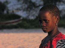 Near Pweto, Katanga, Democratic Republic of Congo: Girl posing for the camera near the shore of Lake Mweru. Near Pweto, Katanga, Democratic Republic of Congo royalty free stock images
