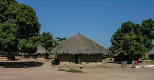 Near Pweto, Katanga, Democratic Republic of Congo : Woman and child standing next to their hut royalty free stock image