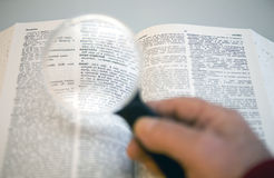 Near sighted,. Close-up shot of a magnifying glass and a dictionary highlighting the word nearsighted Royalty Free Stock Photo
