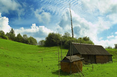 Near the sky. Rural house and stack under impressive clouds Stock Photography