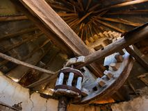 Wooden windmill mechanism, abandoned and ruined stock images