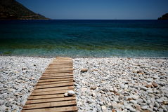 Near Spinalonga. A stone beach in Crete, near Spinalonga island Stock Images