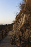 Near the top of the cliff built next to the swim trails. Forests, rocks and the top of the mountain, outdoor, in the evening, white, red, brown, blue, path Stock Photography