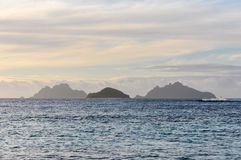 Nearby islands from Mana Sunset Beach in Fiji Royalty Free Stock Photo