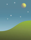 Nearby Planet, or Moon, Above a Grassy Knoll Royalty Free Stock Photo