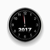 2017 nearly midnight black and silver clock. 3D Illustration of a Silver and Black Clock Signing Nearly Midnight with Twenty Seventeen in Numbers Stock Photos