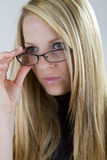 Nearsighted Beauty Looks Over Her Glasses stock images