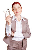 Nearsighted business woman Stock Photo