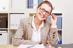 Nearsighted business woman Royalty Free Stock Image
