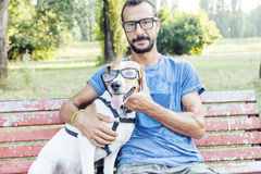 Nearsighted man with his dog wearing glasses Royalty Free Stock Photography