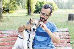 Nearsighted man with his dog wearing glasses Stock Photos
