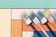 Neat arrangement of paintbrushes on stained wood Stock Photography
