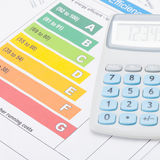 Neat calculator with energy efficiency chart - studio shot Stock Photos
