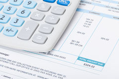 Neat calculator with utility bill under it Stock Photography