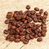 Neat coffee beans over old wooden table Stock Images