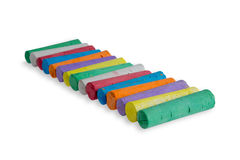 Neat diagonal row of colored chalks Royalty Free Stock Photos