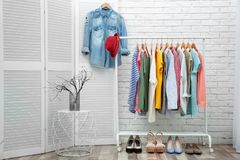 Neat dressing room interior. With clothes rack stock images