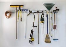 Neat garage tool hanging storage. Neat garage tools hanging on a storage rack royalty free stock photos