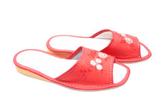 Neat leather slippers on a white. Royalty Free Stock Photography
