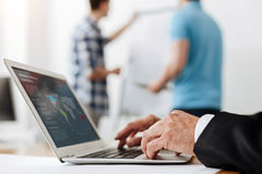 Neat male hands typing on a laptop keyboard Stock Image