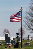 Flag pole memorial in the cemetery stock photography